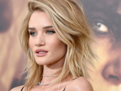 """HOLLYWOOD, CA - MAY 07:  Actress Rosie Huntington-Whiteley attends the premiere of Warner Bros. Pictures' """"Mad Max: Fury Road"""" at TCL Chinese Theatre on May 7, 2015 in Hollywood, California.  (Photo by Frazer Harrison/Getty Images)"""